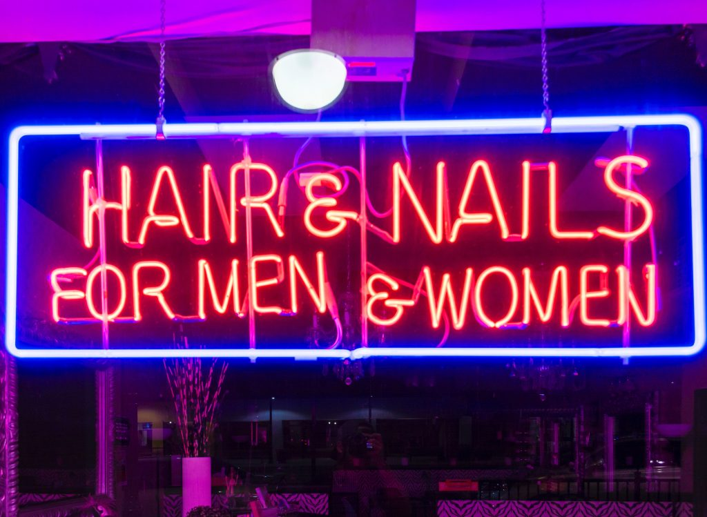 neon sign reading 'hair and nails for men and women'