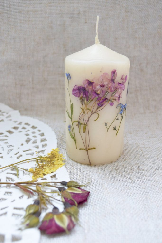 handmade candle with dried flowers